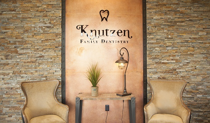Seating area in fornt of Knutzen Family Dentistry sign