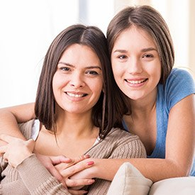 Smiling mother and daughter