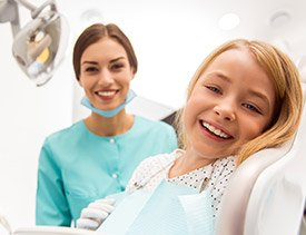 Laughing young girl in dental chair